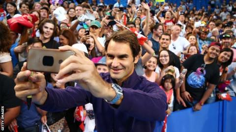 Roger Federer taking a selfie of fans during a Hopman Cup practice session